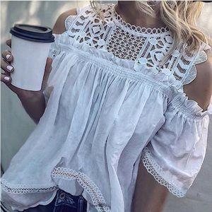 Tops - White poly blend peek a boo shoulder blouse.